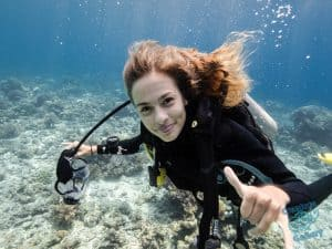 Girl scuba diving without face mask