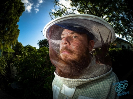 Beekeeper in protective hat