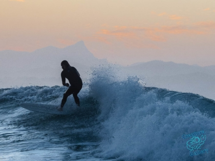 Surfer in front of Wollumbin - Mt Warning