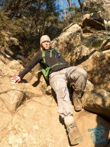 Climber descends rock chimney in Scenic Rim ranges